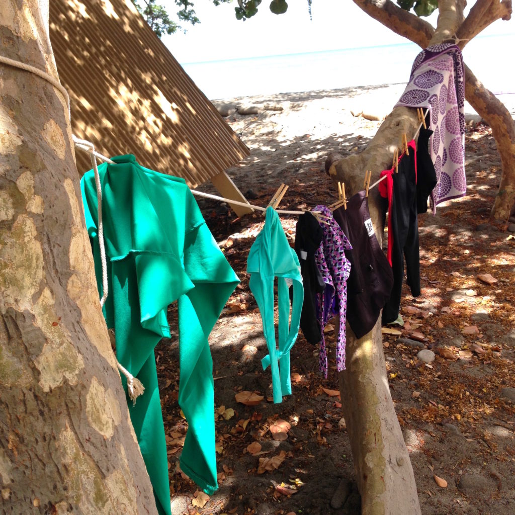 swim suits drying on clotheslines camp packing